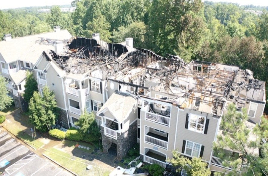 Drone footage of IMT Deerfield apartment complex burned and roof scorched
