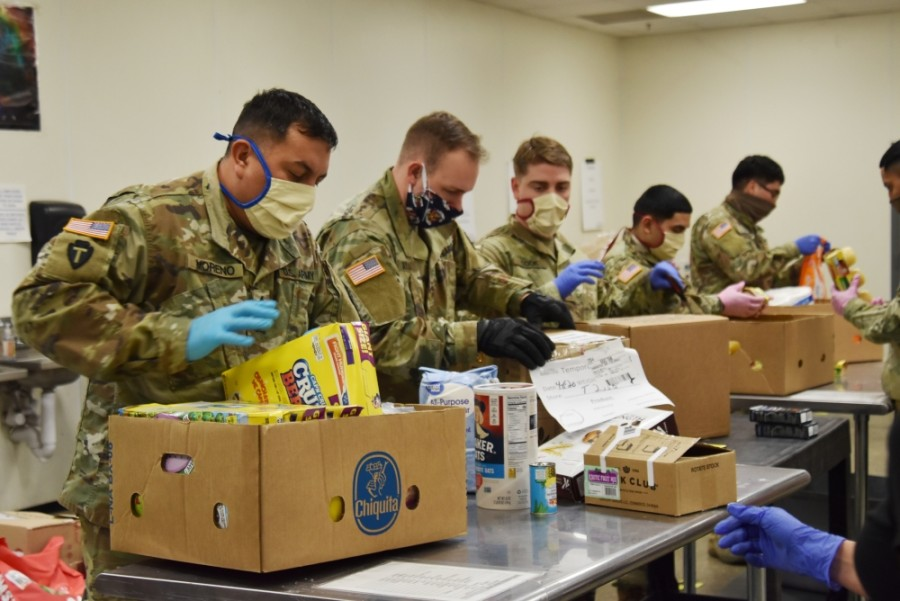 Members of the DCo 536th BSB TX Army National Guard and 147th Attack Wing TX Air Guard sort and pack boxes at the Montgomery County Food Bank. (Courtesy Liz Grimm/Montgomery County Food Bank)