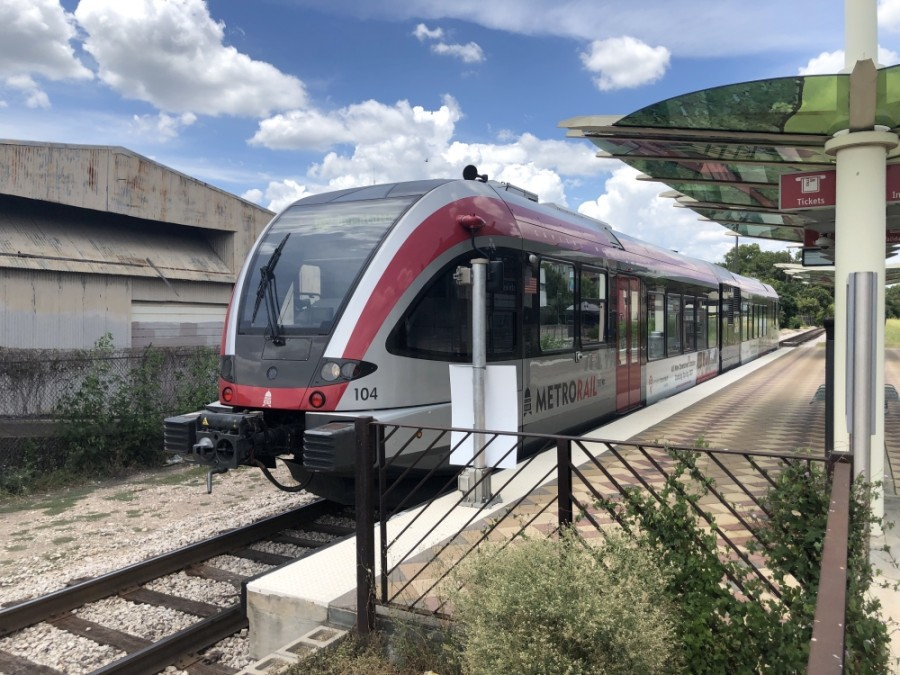 A Red Line MetroRail train moves through the Crestview station on July 22. Capital Metro and the City of Austin are deciding on a framework to send to voters to raise funding for the public transit agency's Project Connect plan. (Jack Flagler/Community Impact Newspaper)
