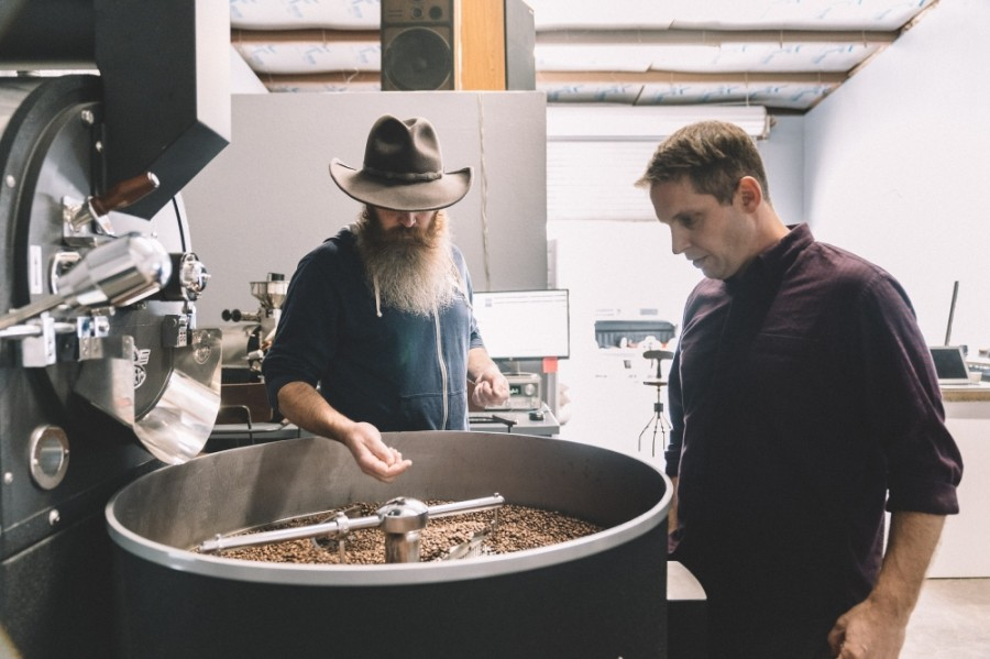 Co-founders Jake Sussman (right) and Alex Noel  prepare a coffee roast. (Courtesy Madrone Mountain Coffee)