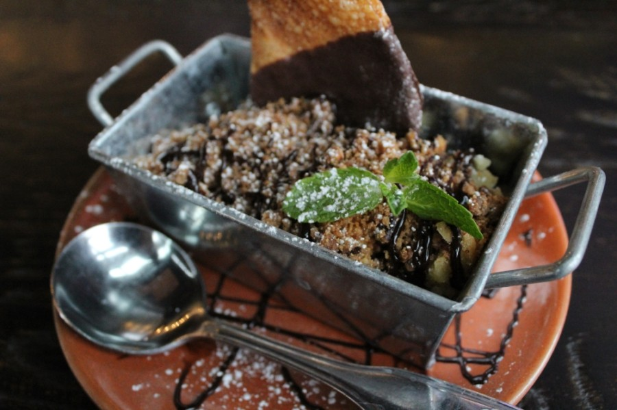 A dessert option from Lambeau's America Kitchen and Taps is the Texas Pecan Cobbler served with a sprinkling of powdered sugar. (Photo by Anna Herod/Community Impact Newspaper)