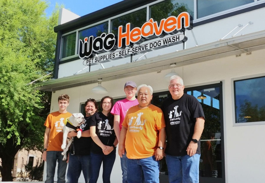 Jeff Manley (far right), Jusak Yang Bernhard (second right) and their staff stand outside the new Wag Heaven location on South Austin Avenue. (Courtesy Wag Heaven)