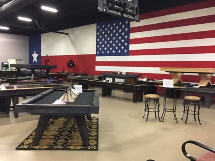 The company sells pool tables and accessories, dart boards, bars and stools, and other game room products. (Courtesy Billiard Factory)
