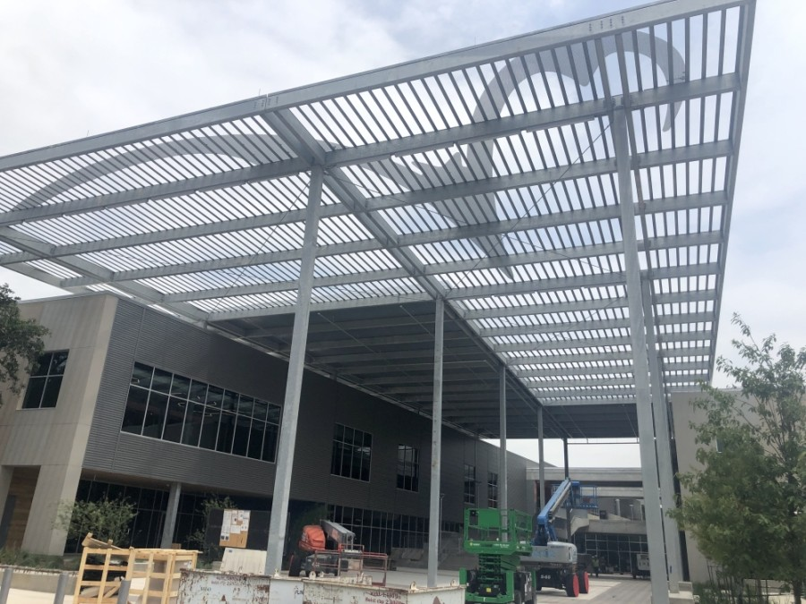 The canopy overlooking the entrance to Austin Community College's under-construction campus features a Riverbat logo. (Jack Flagler/Community Impact Newspaper)