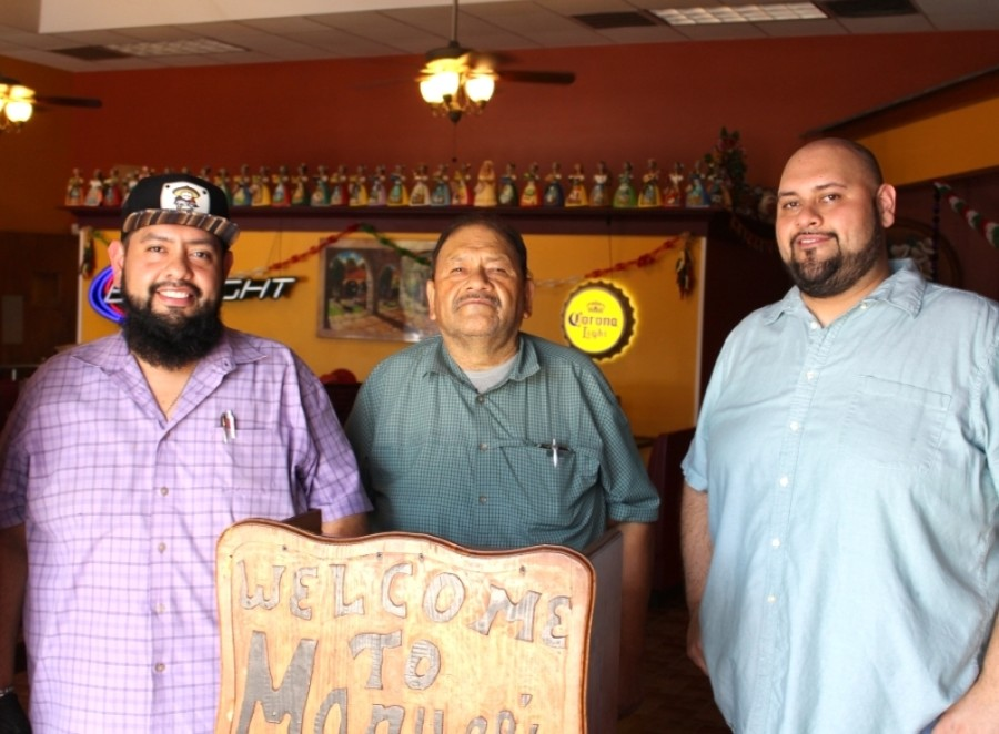 Ramon Reyes (center) opened Manuel's with his brother on FM 1960 in 1987. His two sons, Lupe (left) and Javier (right), run the Summerwood-area eatery.