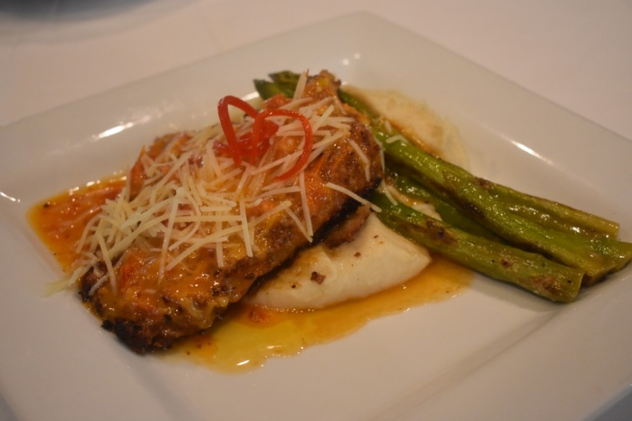 Sun-dried tomato chicken ($23) This dish features Italian crusted chicken cooked in sun-dried tomato lemon butter and topped with Parmesan cheese, with mashed potatoes and asparagus on the side. (Photos by Alex Hosey/Community Impact Newspaper)