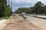 Nearby residents, businesses and commuters will have to endure an extra year of construction along FM 2978, as the four-year widening project will not be completed until 2022, according to mid-July information from the Texas Department of Transportation. (Dylan Sherman/Community Impact Newspaper)