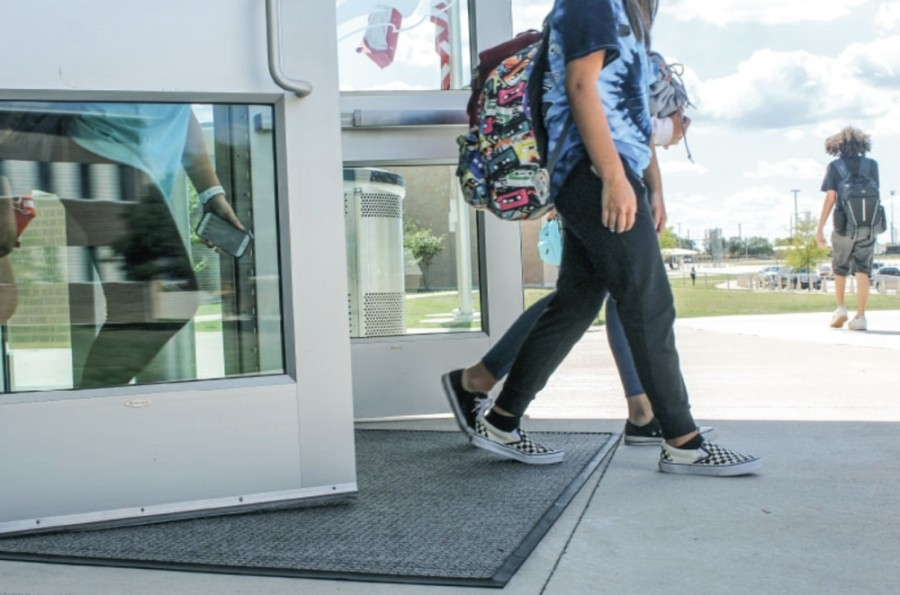 District officials said they believe a hybrid approach is needed for the high school and senior high school students who have opted to return to classrooms later in the year. (Courtesy Adobe Stock)