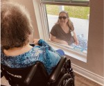 A mother and daughter visit at Seasons Assisted Living & Memory Care in Conroe earlier in the pandemic. (Courtesy Seasons Assisted Living & Memory Care)