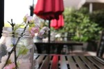 outdoor dining table, umbrella and mason jar
