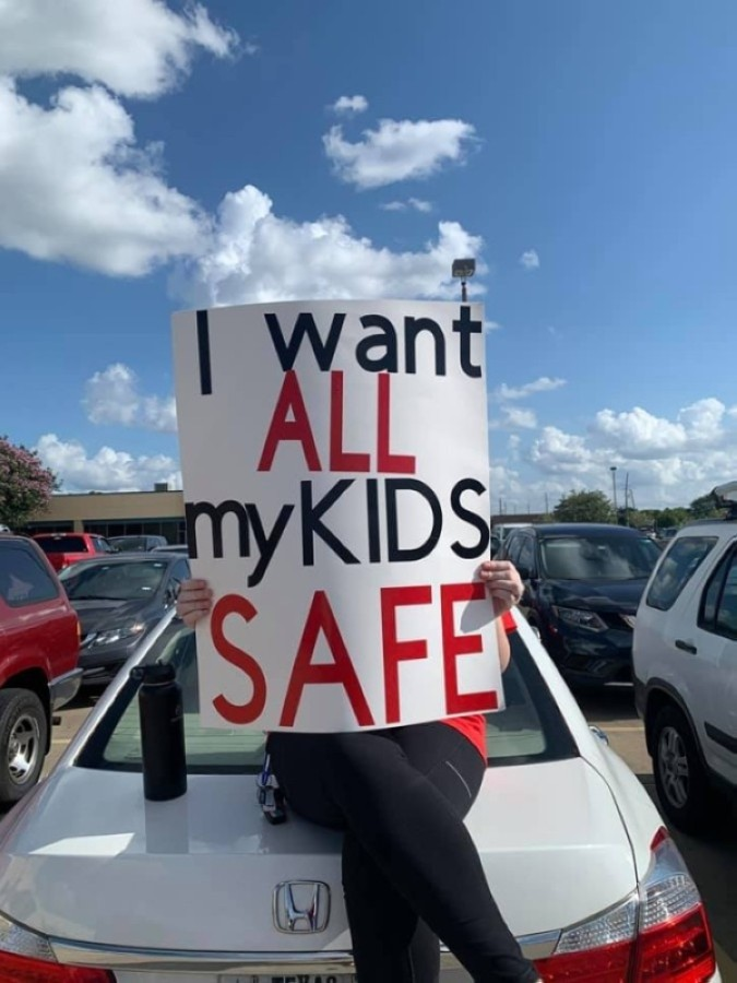 Cy-Fair ISD employees protest with signs in the parking lot outside of the Aug. 10 board meeting. (Courtesy Cy-Fair American Federation of Teachers)