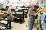 Volunteers at Network helped stock shelves at its food pantry in October 2019. (Olivia Lueckemeyer/Community Impact Newspaper)
