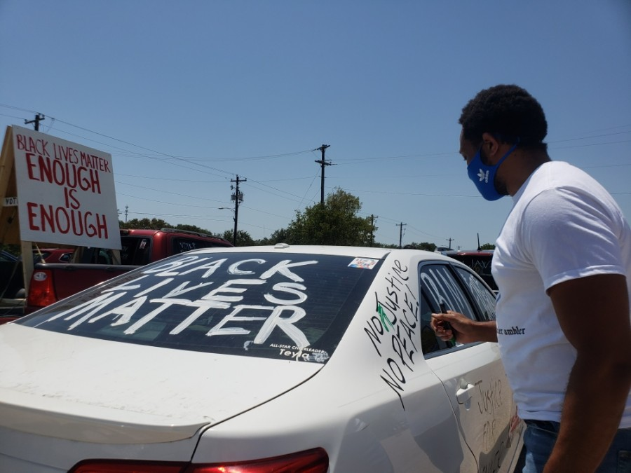 Roy Wood decorated his car for the Pushing for Justice Caravan for Javier Ambler on Aug. 15. (Ali Linan/Community Impact Newspaper)
