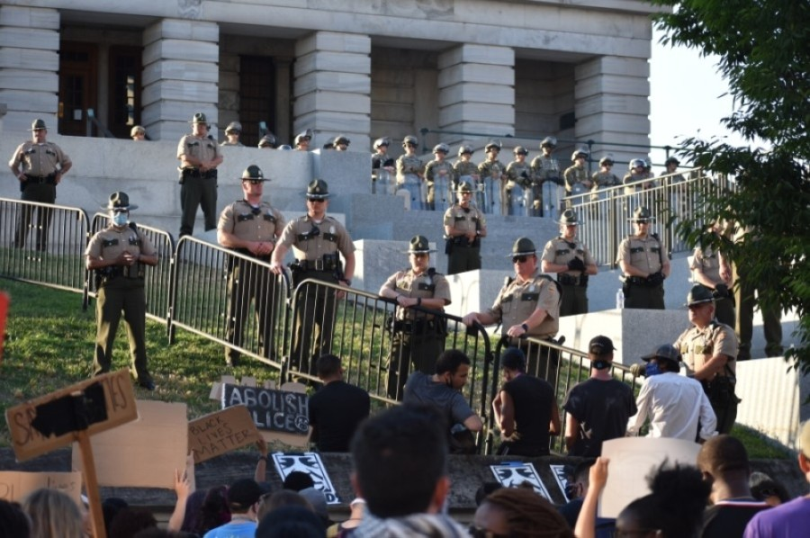 Law enforcement officers and the National Guard blocked the steps leading up to the state capitol June 13. (Alex Hosey/Community Impact Newspaper)