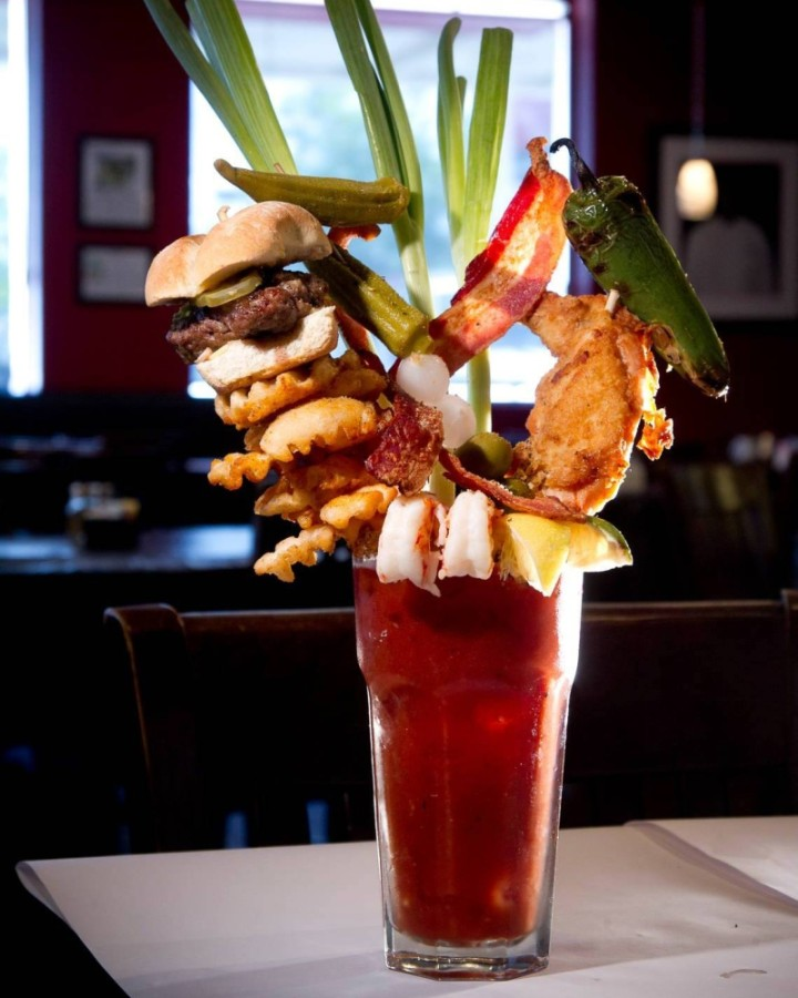This bloody Mary includes a skewered slider, fried chicken, waffle fries and more. (Courtesy Chef Point Bar & Restaurant)