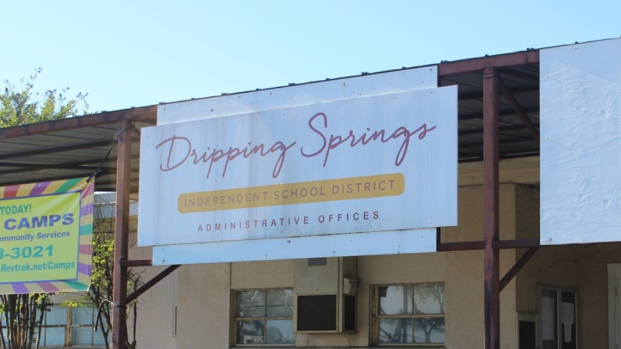 A photo of a Dripping Springs ISD sign