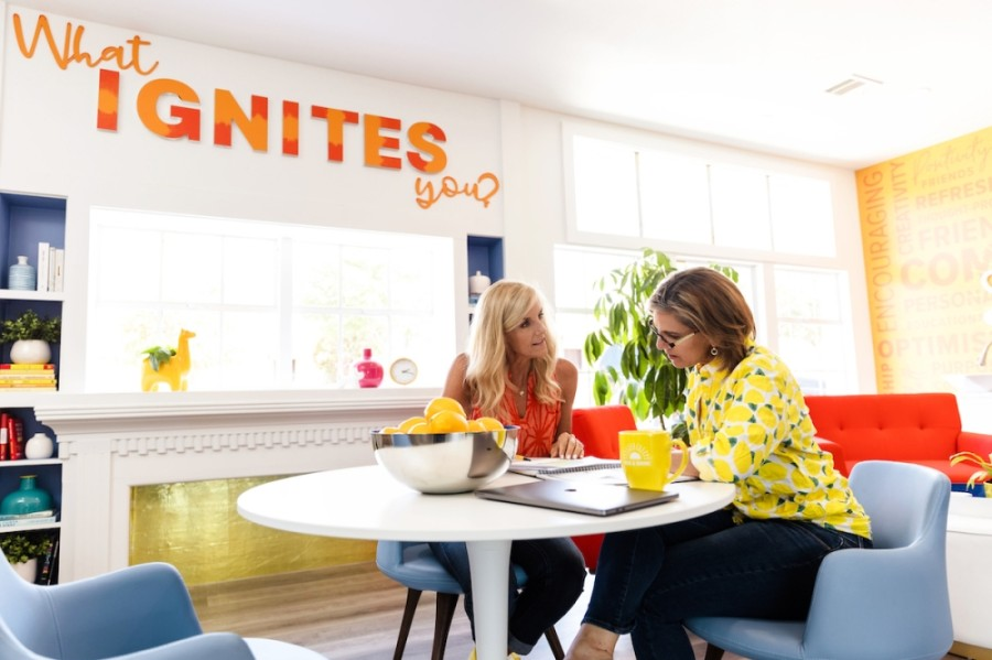 Claudia Beeny (right) sits in the community commons area of House of Shine's Grapevine digs. (Courtesy House of Shine)