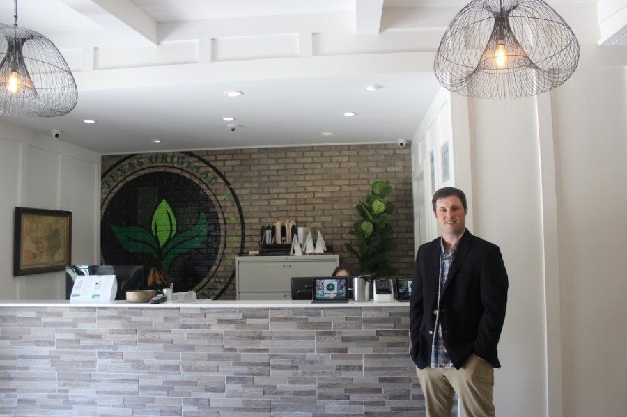 Mike Rubin, co-founder and vice president of business development for Compassionate Cultivation, stands in the company's dispensary. (Olivia Aldridge/Community Impact Newspaper)