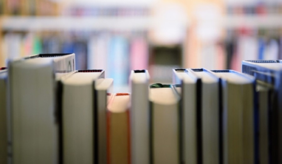 Students can reserve books through their library account and pick up the materials curbside at district campuses. (Courtesy Adobe Stock)