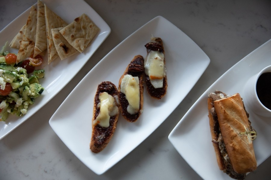 (Left to right) Among Edith's French Bistro menu offerings are the Almost Naked Salad (Small $7/Large $12), Brie and Fig Tartine ($8) and the French Dip ($9) sandwich. (Liesbeth Powers/Community Impact Newspaper)