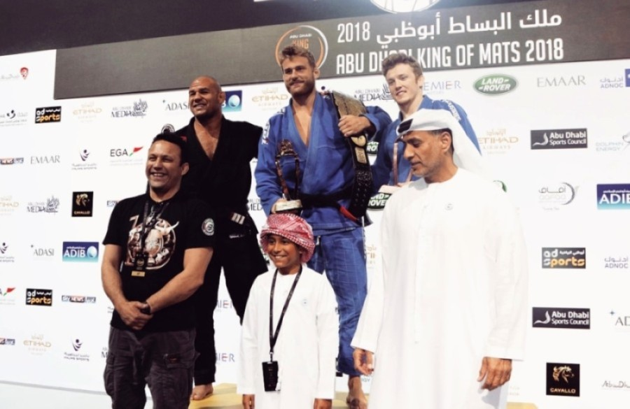 Alexander Hilligsoe Trans (center) is a former jiujitsu fighter who has competed and earned top titles in national and world championships. He will open his first gym, Progresso Jiu Jitsu, in Plano in mid-September. (Courtesy Alexander Hilligsoe Trans)