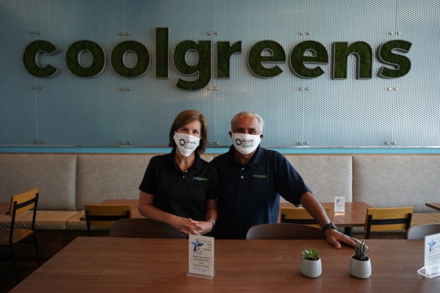 Shanna and Luis Argote signed the Southlake Safe pledge for the restaurant, Cool Greens. (Gavin Pugh/Community Impact Newspaper)