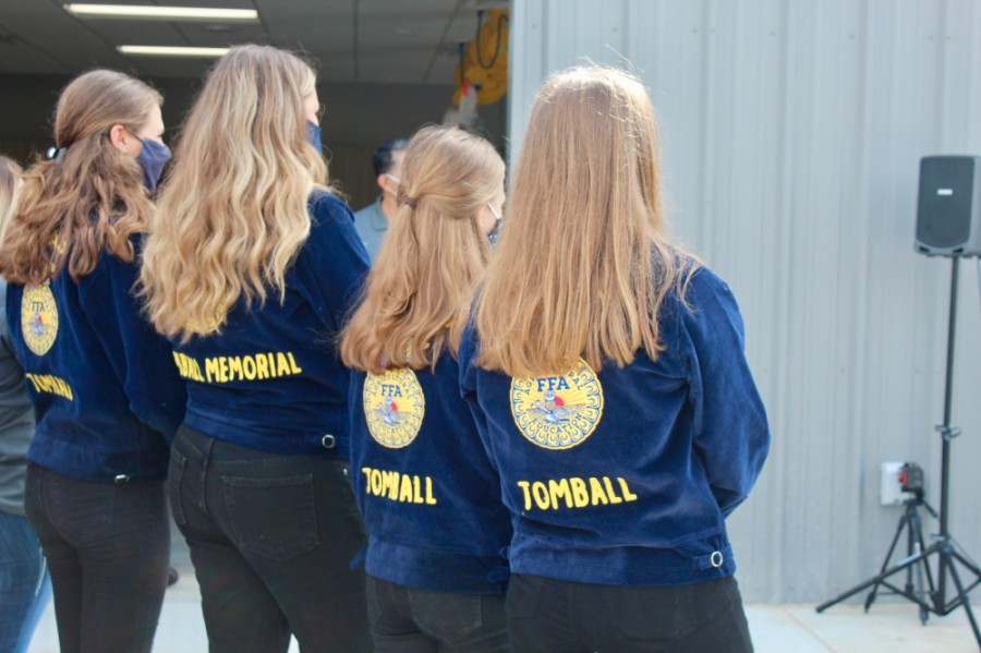 Several FFA students from Tomball Memorial and Tomball high schools attended the ribbon-cutting with district leadership Sept. 4. (Anna Lotz/Community Impact Newspaper)