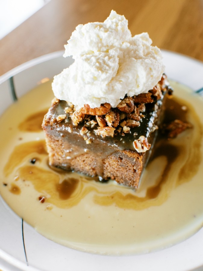 The namesake Whiskey Cake features a toffee torte topped with bourbon anglaise, spiced pecans and whipped cream. (Courtesy Whiskey Cake)