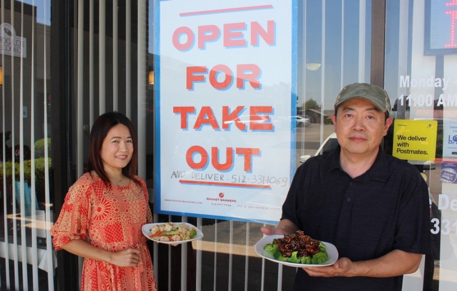 Laney Vo and Dinh Tran stand outside Hunan Chef, Cedar Park's oldest Chinese restaurant. (Brian Perdue/Community Impact Newspaper)