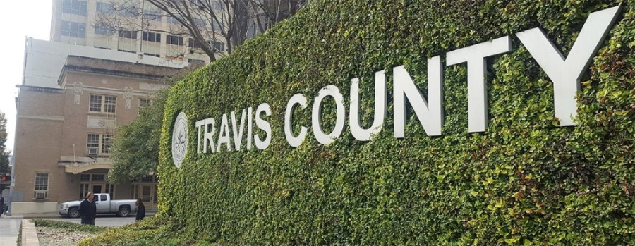"Photo of a sign that reads ""Travis County"""