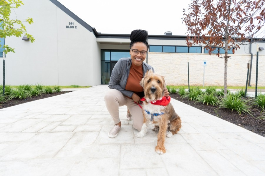 Shakkal Ware, Firehouse Pet Resort's resort supervisor, poses with Ganon. Firehouse Pet Resort is anticipated to open in Round Rock on Sept. 21. (Courtesy Daniel Crotty Photography)