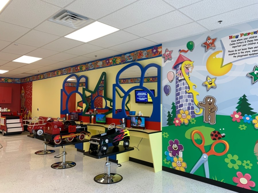 Children can sit in fantasy car salon booster seats and watch TV that show a variety of kids shows and games. (Cookie Cutters Haircuts for Kids)
