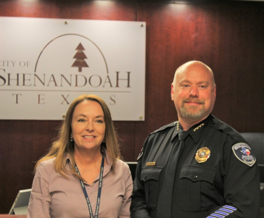 Shenandoah Chief of Police Troye Dunlap (right) has his photo taken with Shenandoah City Administrator Kathie Reyer during a Sept. 9 City Council meeting. (Courtesy Debbie Pilcher)