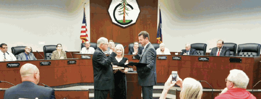Conroe Mayor Toby Powell was sworn in to office by Sen. Brandon Creighton on July 6, 2016. His term was to expire this November. (Community Impact Staff)