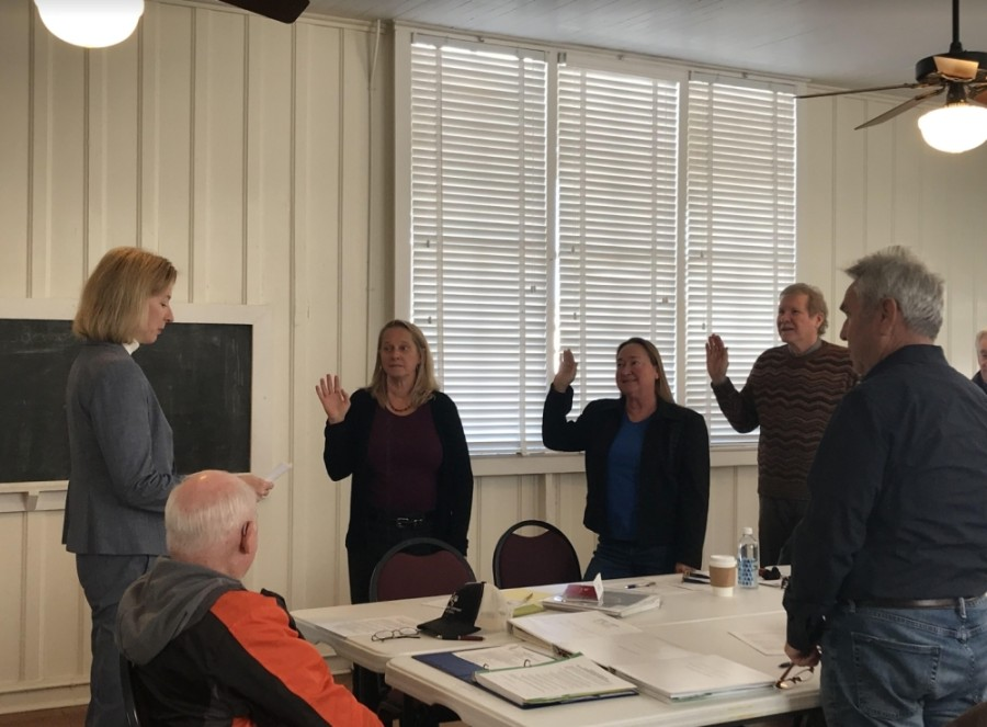 State Rep. Vikki Goodwin (left), D-Austin, swears in the newly elected directors of the Southwest Travis County Groundwater Conservation District on Nov. 15. (Amy Rae Dadamo/Community Impact Newspaper)