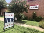 A sign directs voters inside at Ridgetop Elementary School during the July 14 elections in Austin. Historically, AISD campuses have been used as Travis County polling locations for elections. (Jack Flagler/Community Impact Newspaper)