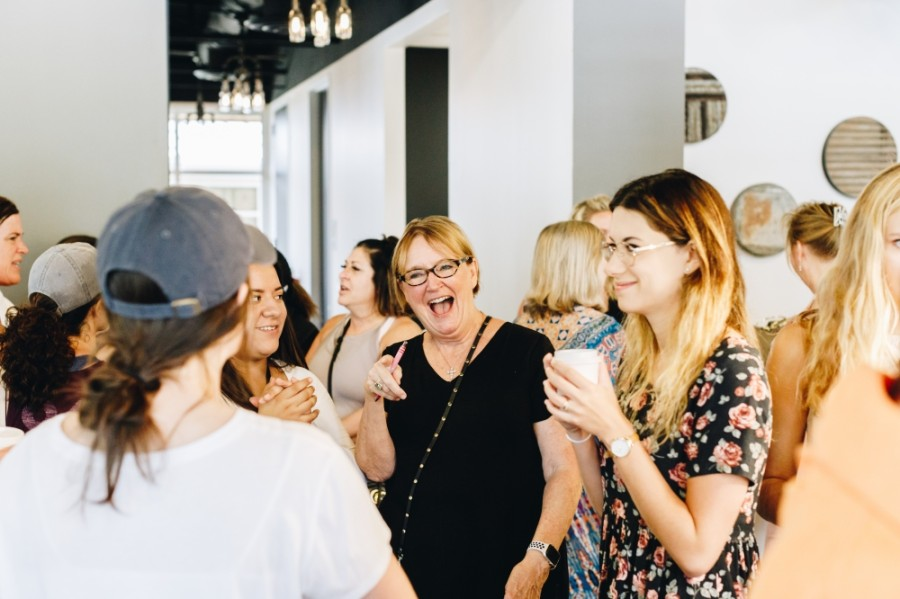 """Lovebeans Coffeehouse owner Beth Ferester socializes with guests to the first """"pop-up"""" prior to its formal opening.  (Photos courtesy Lovebeans Coffeehouse)"""