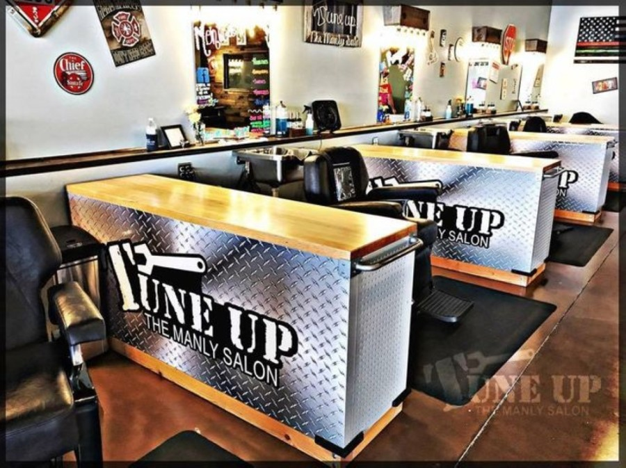 Both locations specialize in men's haircuts, shaves and waxing, and they also offer complimentary alcoholic drinks. (Courtesy Tune Up: The Manly Salon)