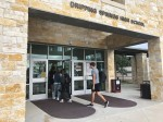 Photo of students entering Dripping Springs High School with masks on