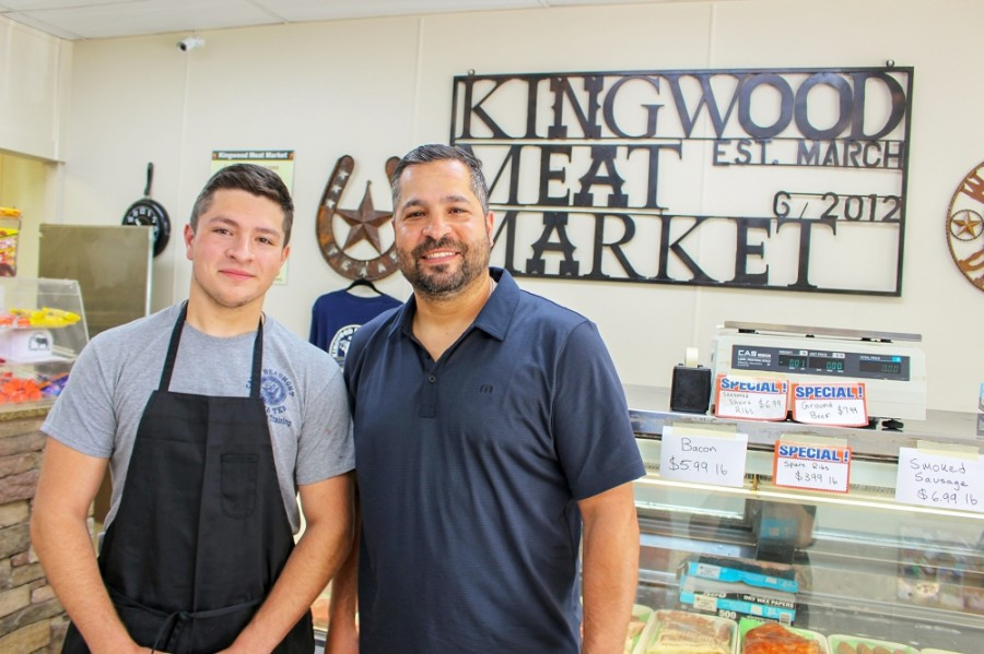 Eduardo Garza (right) opened Kingwood Meat Market with his wife, Jennifer in 2012. His son, Miguel (left) and daughter help run the business. (Kelly Schafler/Community Impact Newspaper)