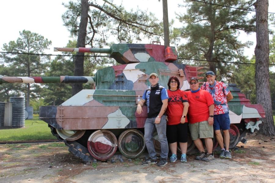 From left: Austin McNeill, Kelly McNeill, Darrell McNeill and Manager Danny Powell run TXR Paintball. (Shawn Arrajj/Community Impact Newspaper)