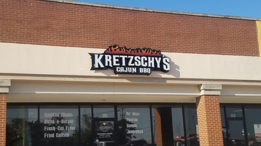 Menu options at Kretzschy's Cajun BBQ include smoked meats, burgers, po'boys, and fried chicken and catfish. (Community Impact Staff)