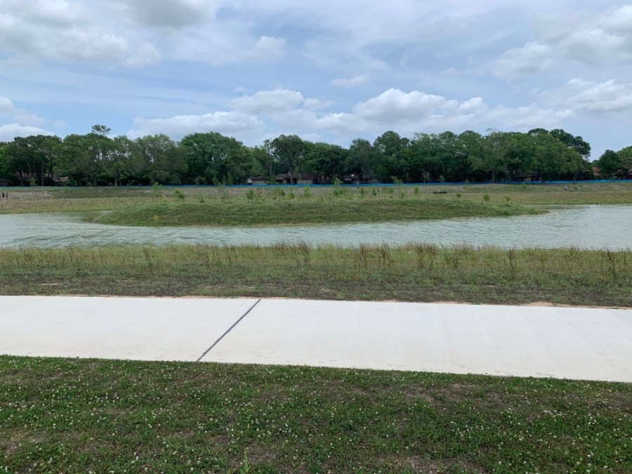 Phase 2 of Exploration Green features a 26.2-acre detention pond, 18 acres of natural habitat with wetlands and 1.3 miles of trails. (Courtesy of LAN)