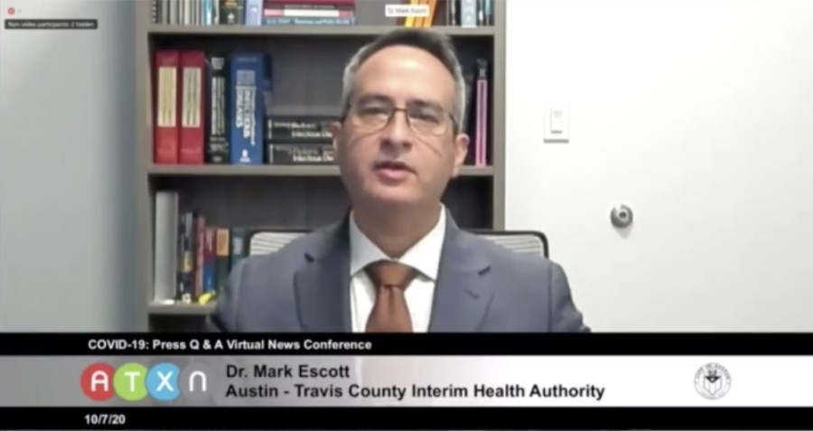 A screen shot of Dr. Mark Escott speaking at a virtual press conference