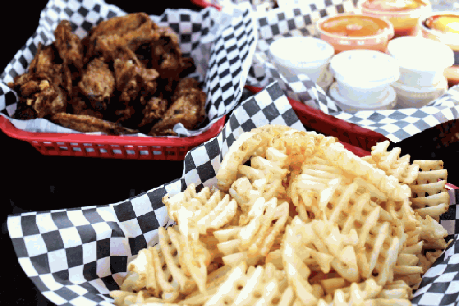 The eatery specializes in double-fried chicken wing dishes served with a variety of sauces, including buffalo, mango habanero and garlic Parmesan, among others. (Courtesy WingNuts Express)