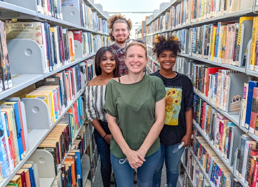 Left to right, Brittany Muoneke, Aaron Hand, Brooke Pillifant and Erika Mitchell are members of Down South Word of Mouth, a nonprofit that provides narrative therapy to inmates. (Warren Brown/Community Impact Newspaper)