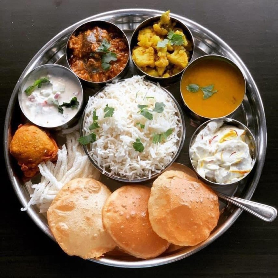 Thali $12.99: Thali translates to plate and is a round platter that includes curry, vegetables and rice.  (Courtesy Megha Ozarker)