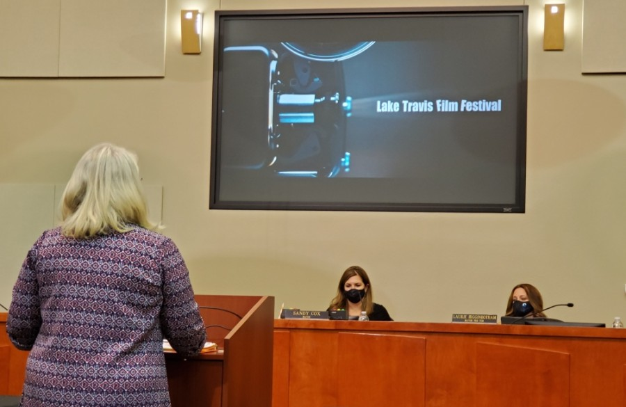 Kat Albert (left), the executive director of the Lake Travis Film Festival, delivers a presentation at the Oct. 19 Lakeway City Council meeting as Mayor Sandy Cox (center) and Mayor Pro Tem Laurie Higginbotham look on. (Brian Perdue/Community Impact Newspaper)
