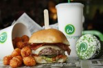 The BBQ bacon burger at Wahlburgers is topped with white cheddar cheese, bacon, avocado, jalapeños and barbecue sauce. (Courtesy Wahlburgers)