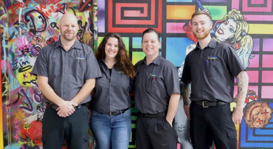 Kraken Motorsports is a mechanic and performance shop owned by Alicia and Shawn Rizzo, pictured in the center. Team members also include Josh Duncan and Phillip MacPherson. (Courtesy Kraken Motorsports)